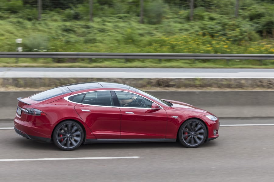 A Tesla Model S driving down the highway