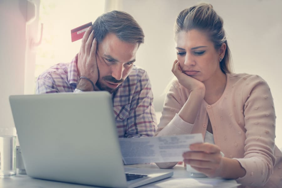 A young couple reviews their taxes
