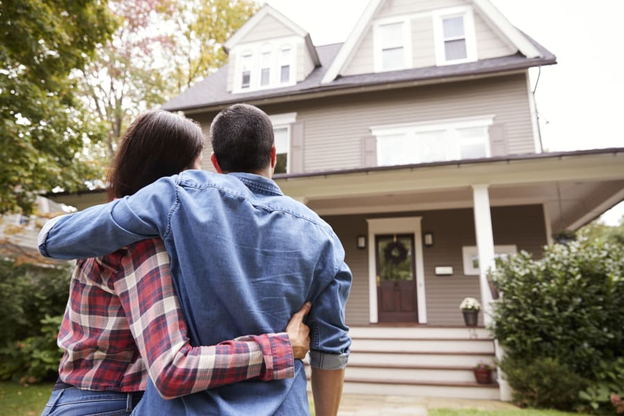 A young couple looks at their new home