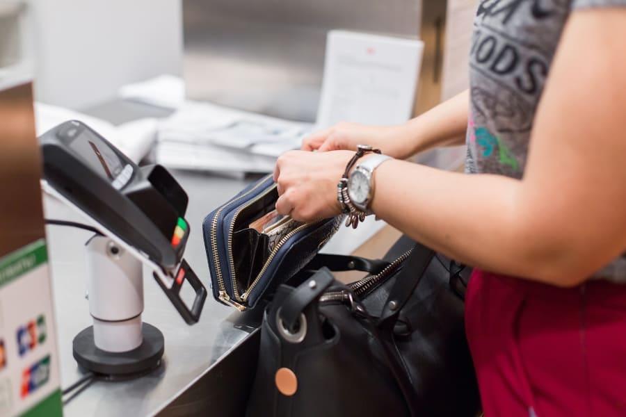 A woman checks out at a Walmart register