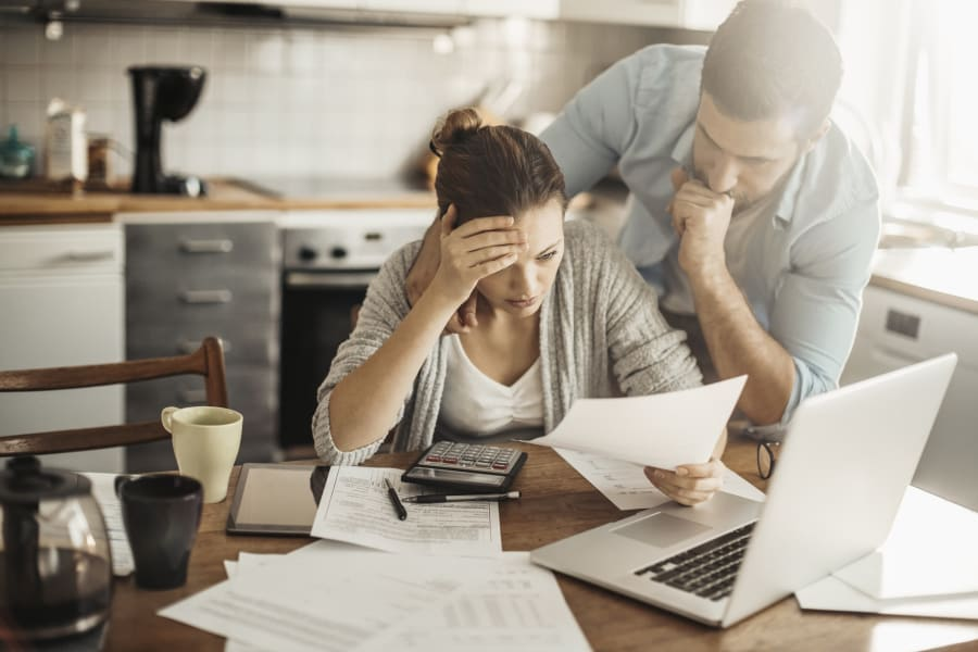 A couple reviews their student loan debt