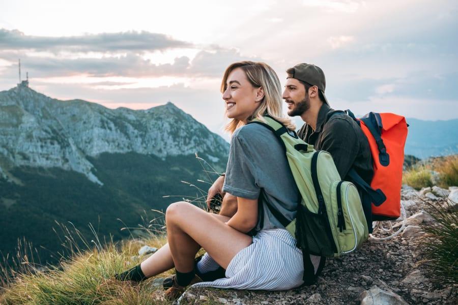 A couple enjoy a mountain view.