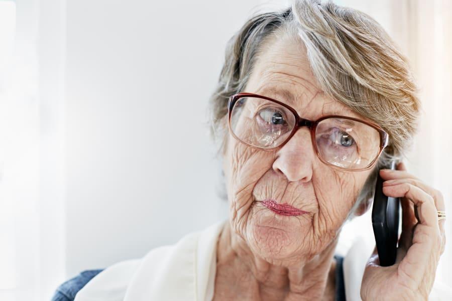 An elderly woman on her phone