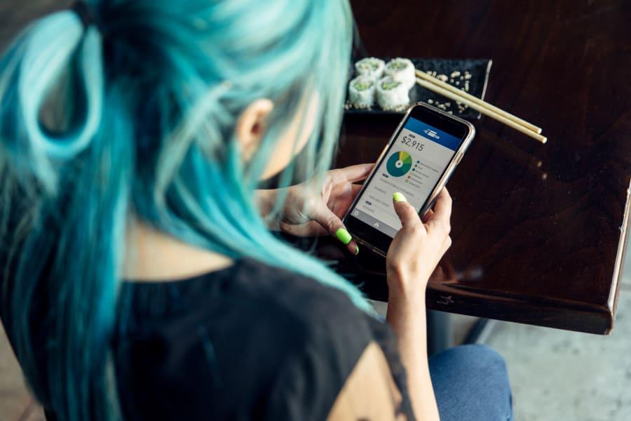 A Millennial checks their credit card spending