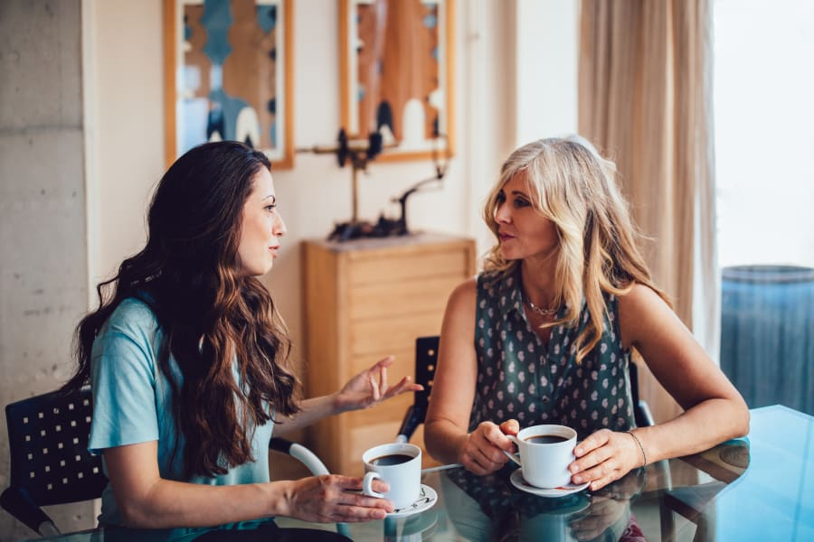 Two women talk while having coffee