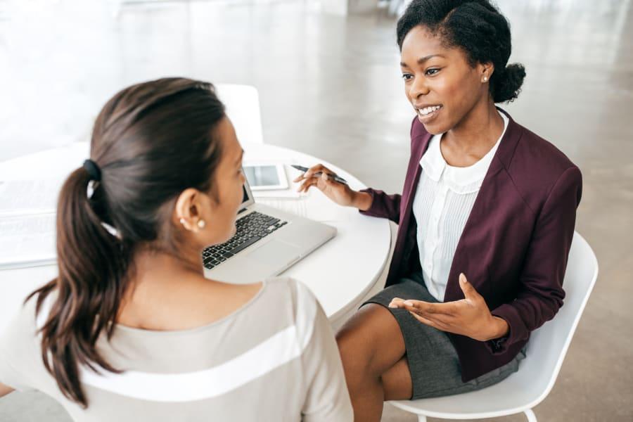 A woman negotiates a raise