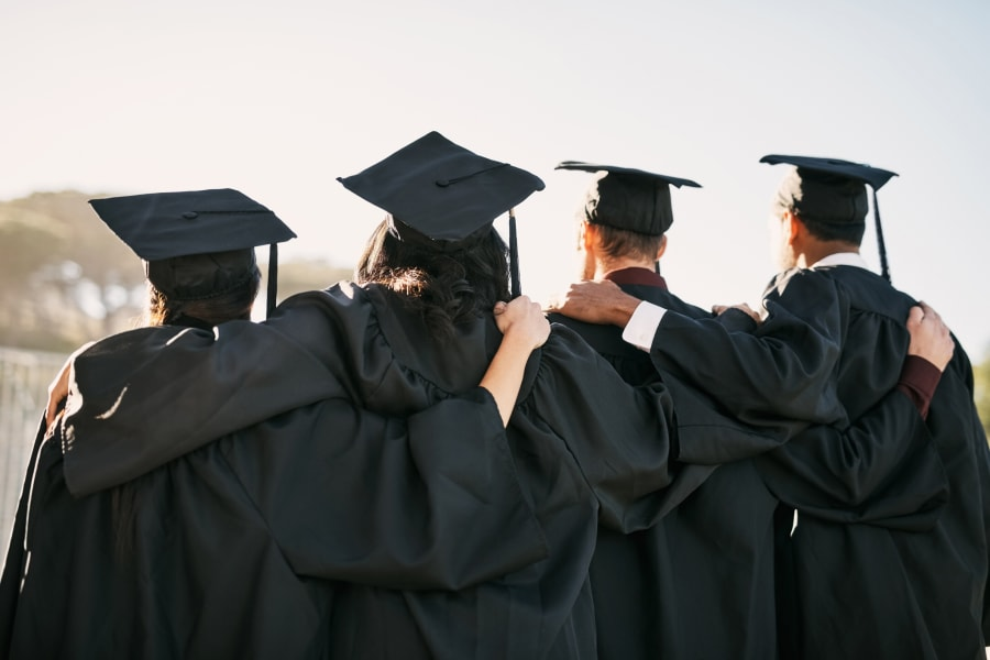 Graduates stand in a line