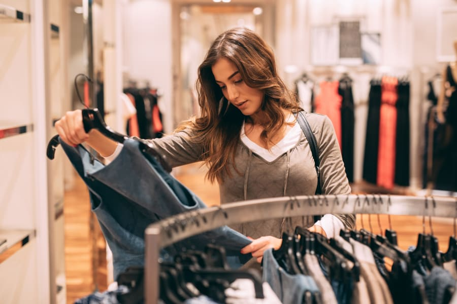 A woman shopping for clothing
