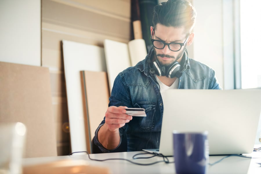 small business owner using credit card