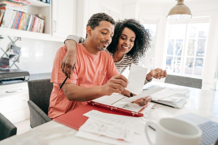 A couple reviews their finances