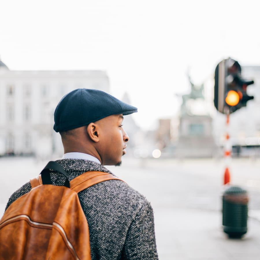 A man stands on a corner.