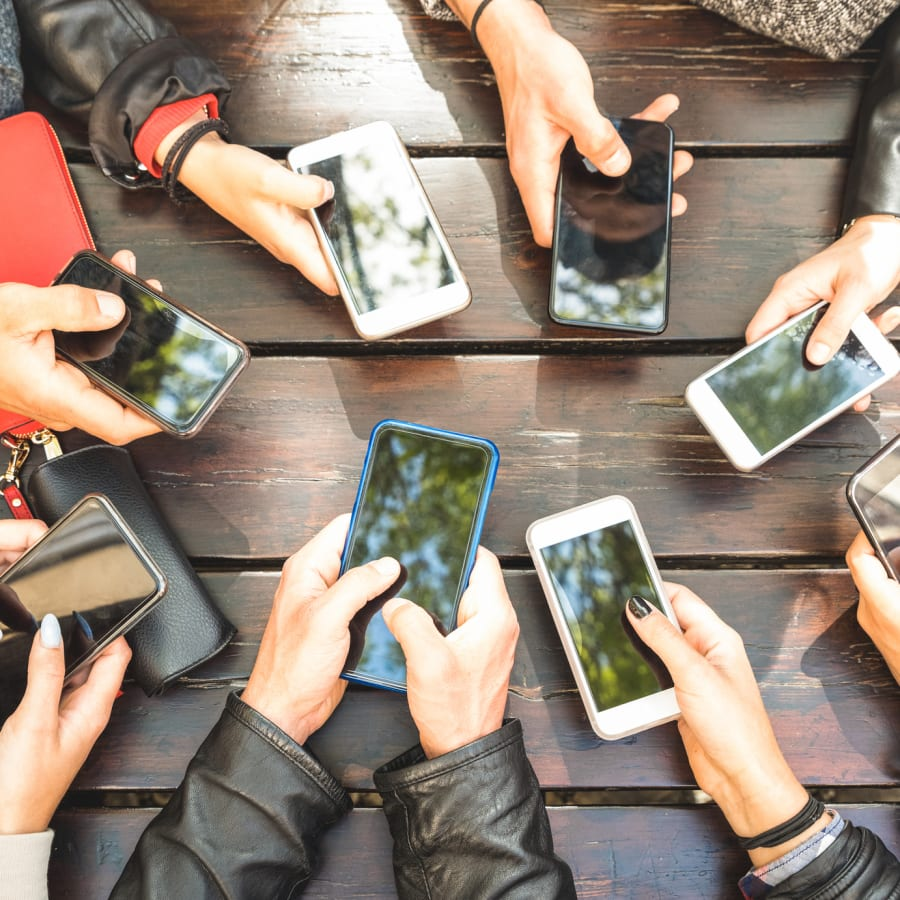 A group of people holding their cell phones