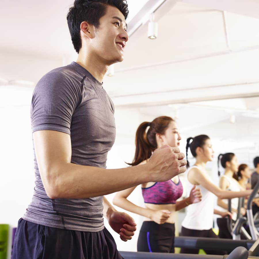men and women exercising in a gym in singapore