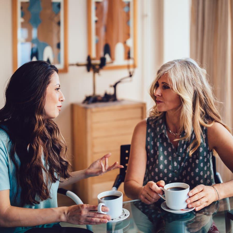 Two women talk while having coffee