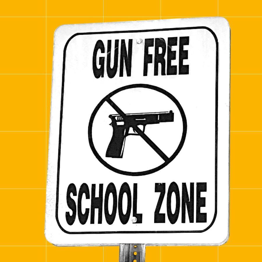 "Sign saying ""gun free school zone"""
