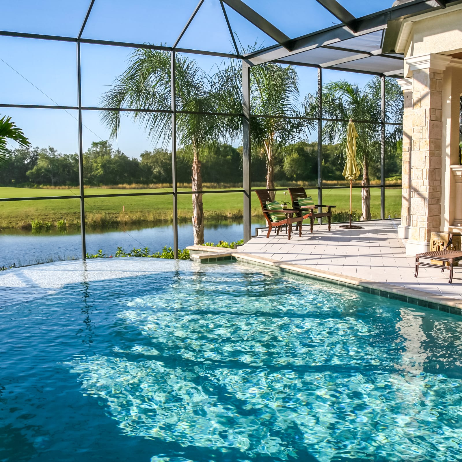 Mansion with indoor pool with diving board  How A Pool Affects Your Homeowners Insurance - ValuePenguin