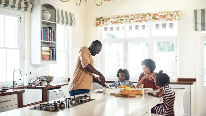 An African-American family enjoys a family dinner in their home