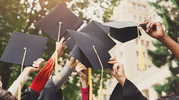 These graduates still have to pay their student loan debt.