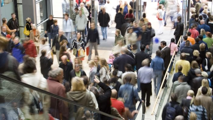 Crowds file into a shopping mall on Black Friday