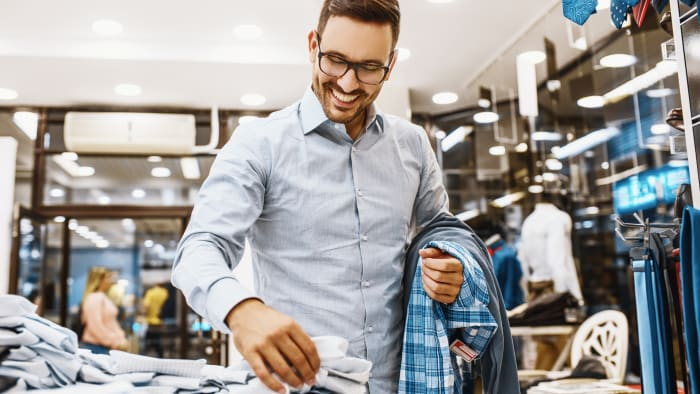 A man shops for clothing