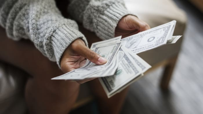 A person holds cash