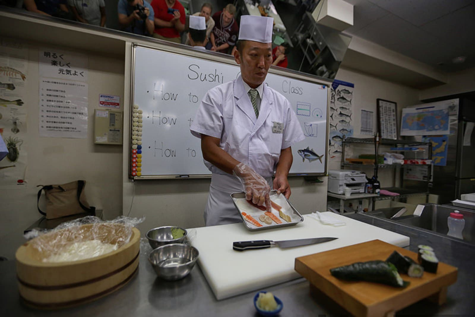 Learning how to roll sushi from a master