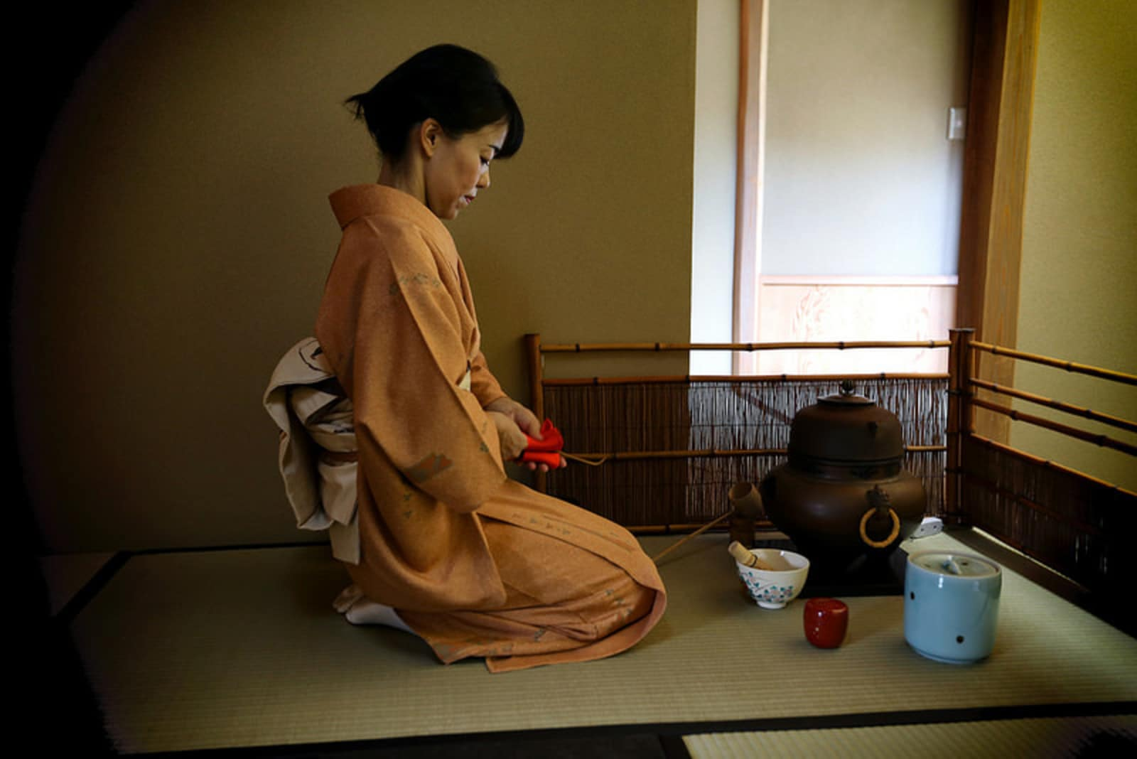 A woman follows the ancient rituals of the Japanese tea ceremony