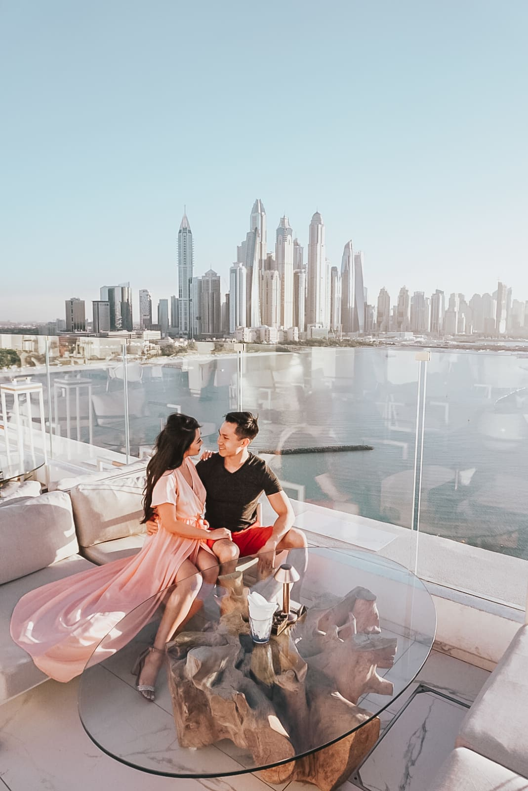The couple look into each other's eyes while on the rooftop in Dubai.