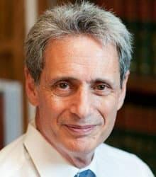 A headshot of Steven J.J. Weisman
