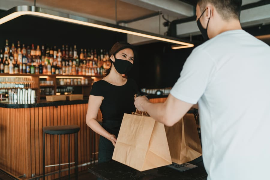 COVID-19 has made food delivery a difficult but necessary service for thousands in Singapore.
