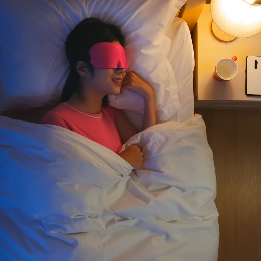 Woman sleeping with an eye mask on