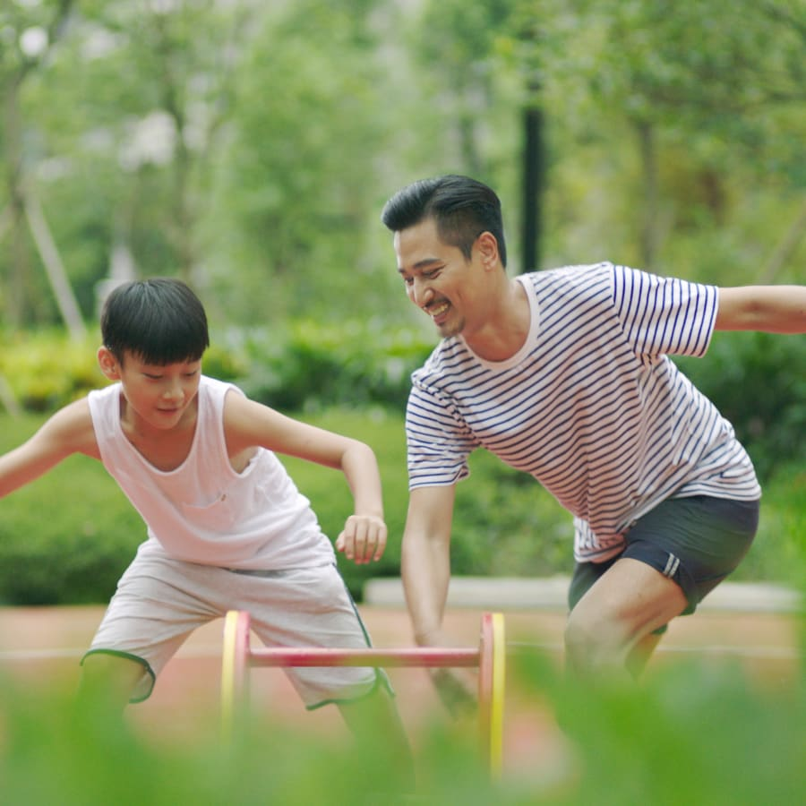 healthy expat family is playing basketball