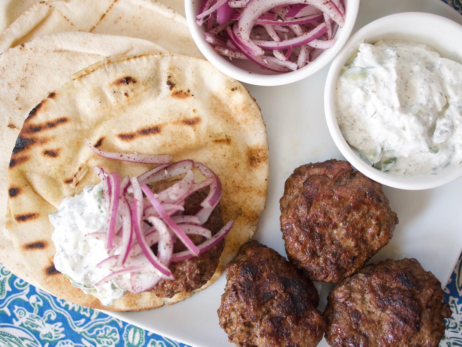 Harissa Lamb Burgers with Feta Tzatziki and Sumac Onions