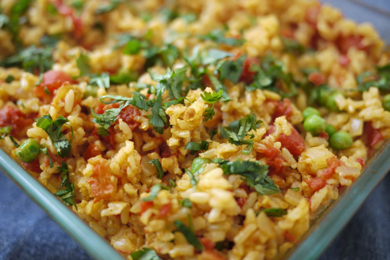 Curried Baked Brown Rice with Tomatoes and Peas