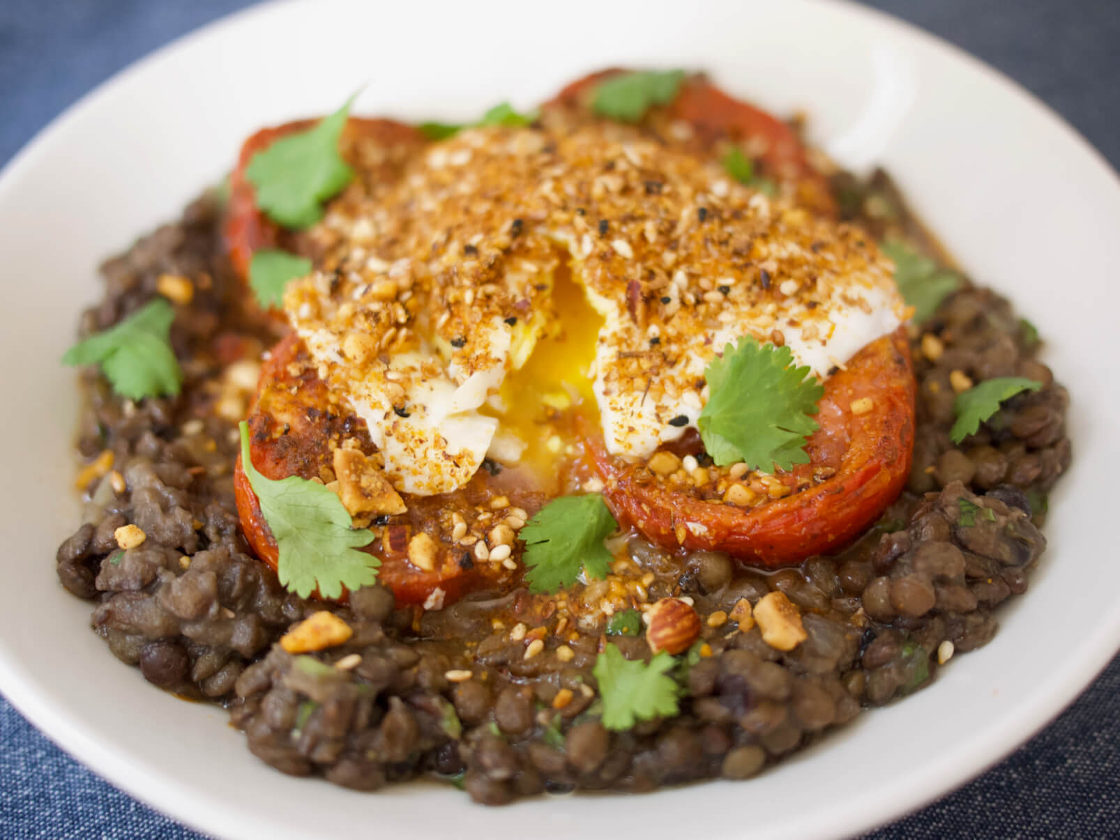 Harissa-Roasted Tomatoes with Lentils, Poached Eggs, and Dukkah