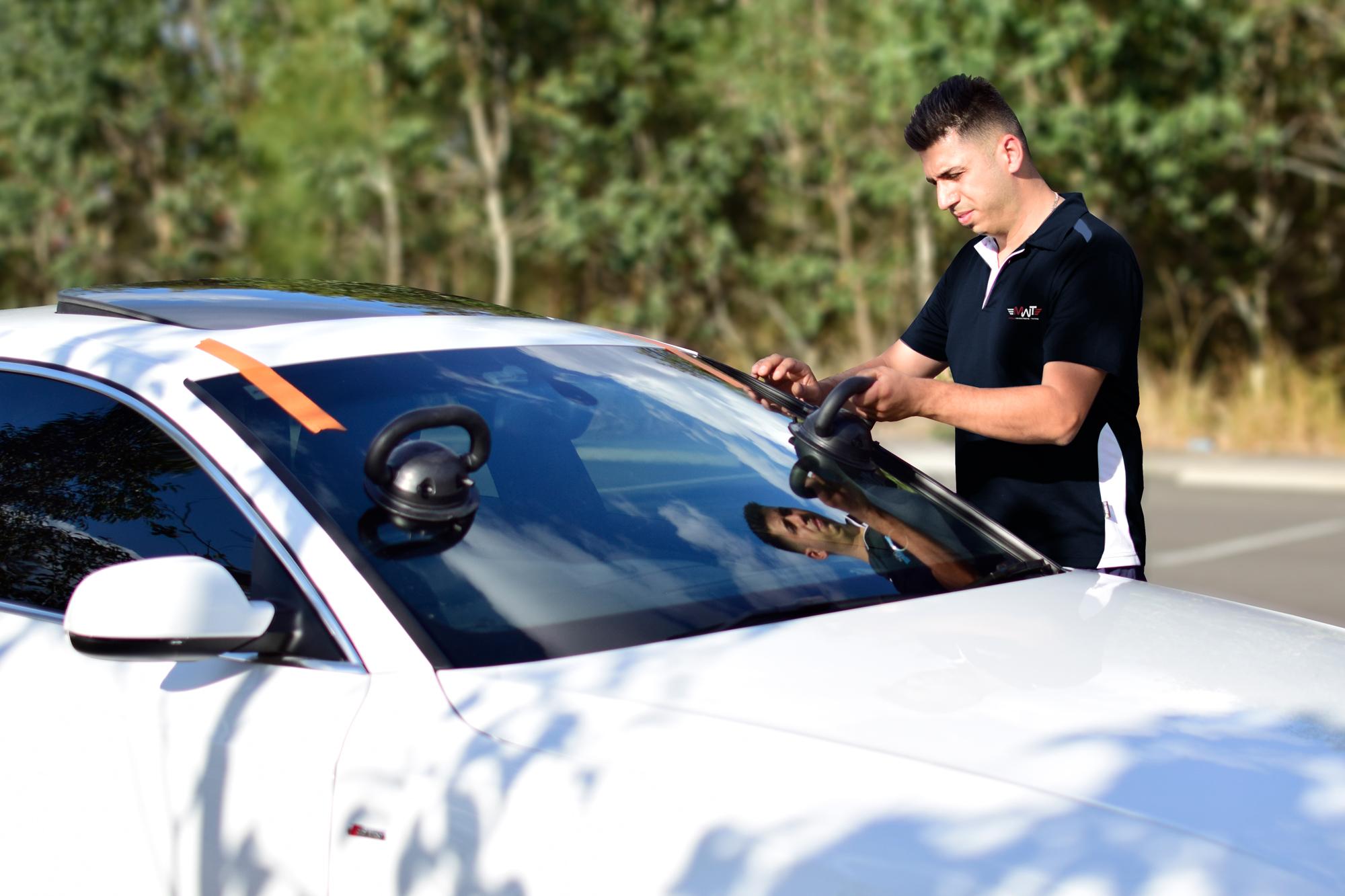 MWT Technician Replacing Car Windscreen