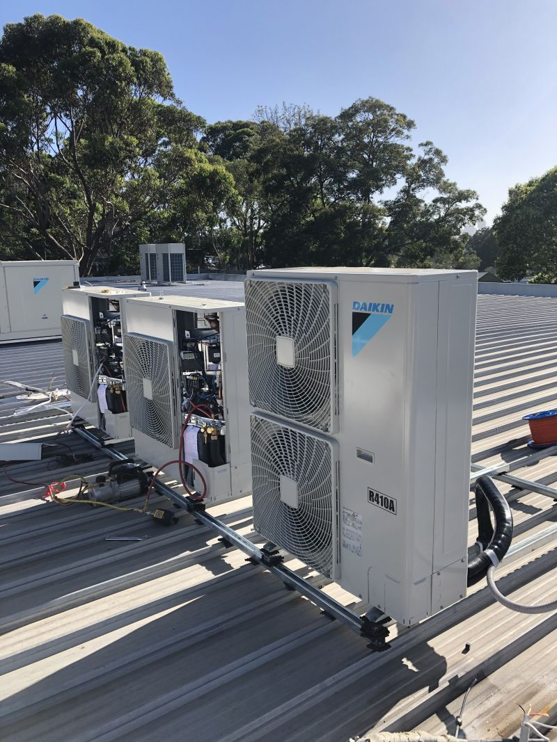 Commercial size air conditioning unit on building roof
