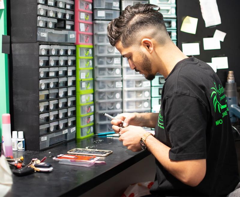 Mobile phone repair technician working