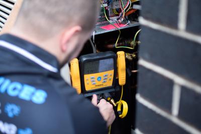 Technician servicing air conditioner unit