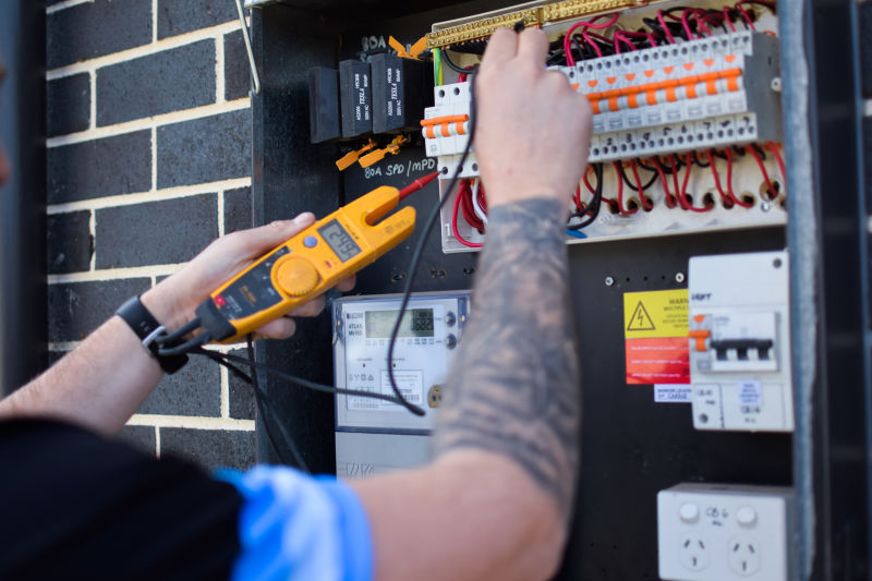 HQ Technician Performing an Electrical Inspection