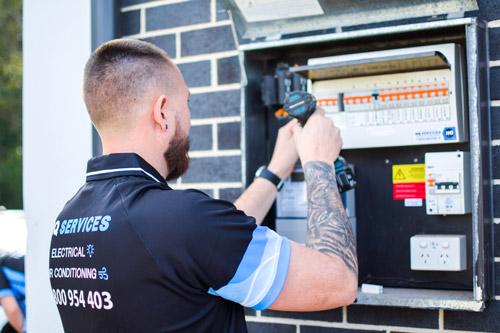 HQ Technician Installing Surge Protectors