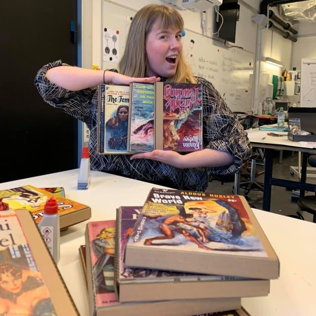 Josephine showing the books