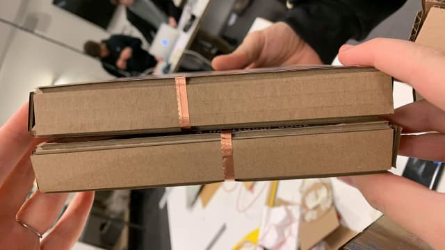 Pattern of copper tape connects the books