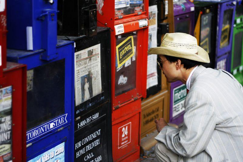 Man reading headlines