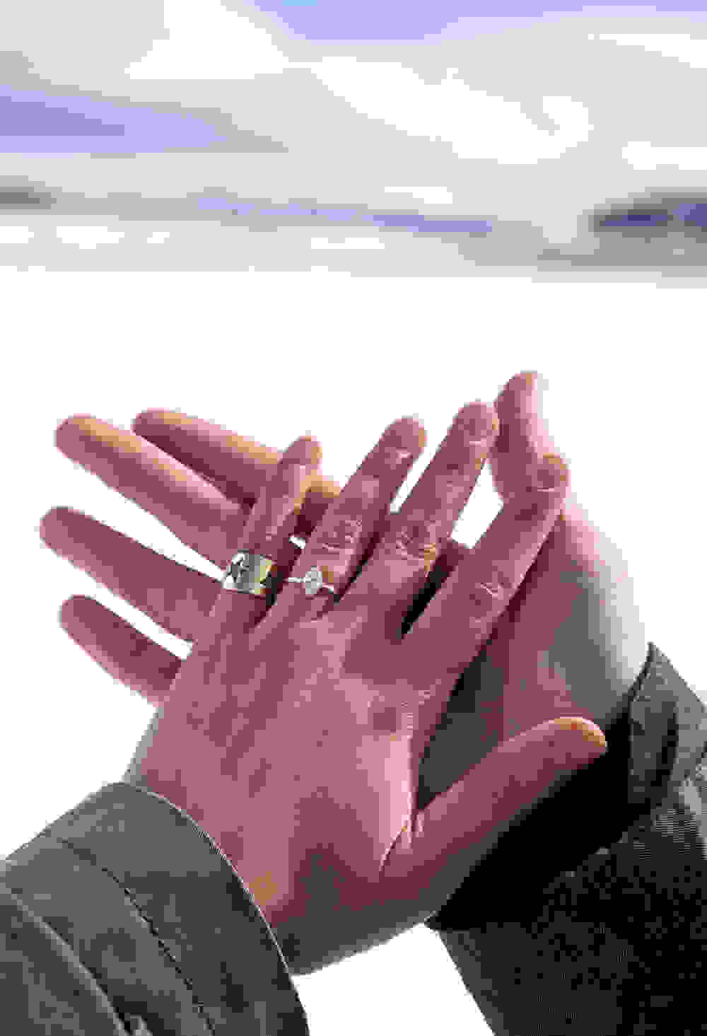 our hands together with the engagment ring