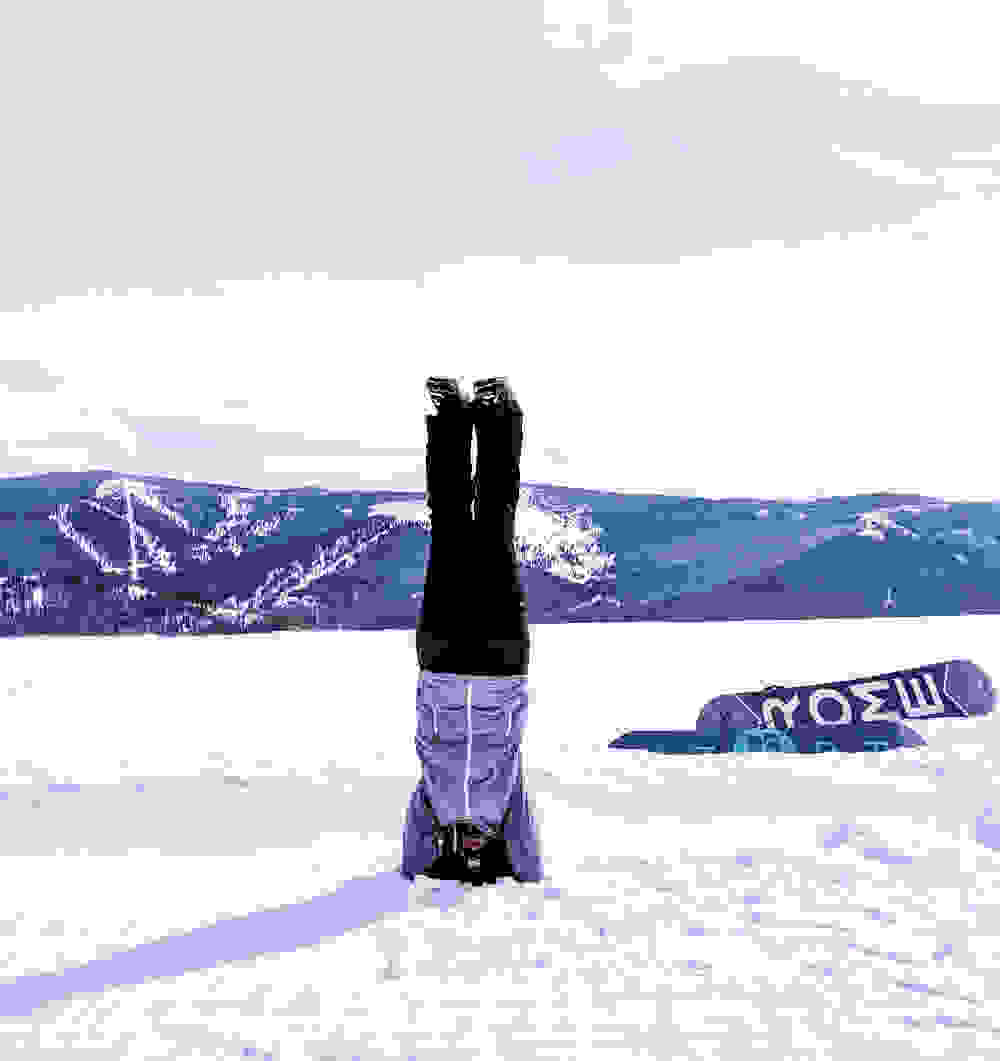 practicing a head stand in the snow