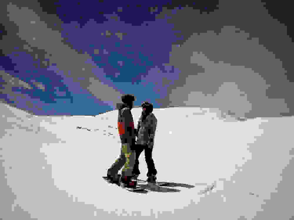 the two of us snowboarding under the full moon light
