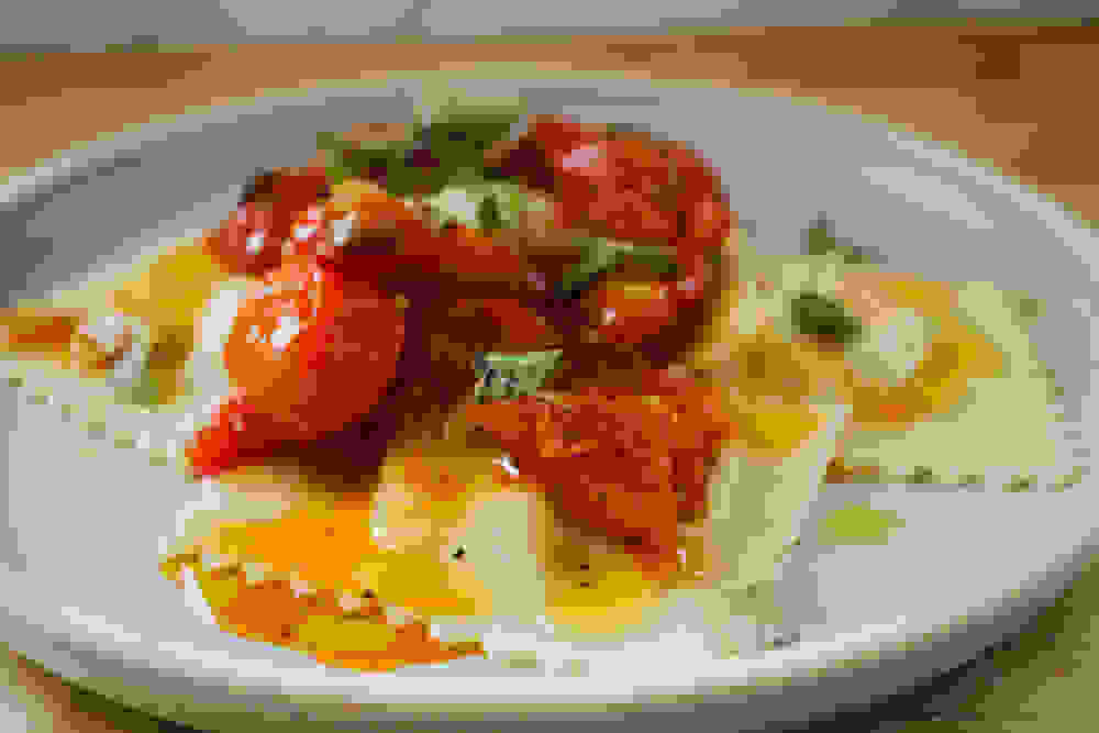 spinach ricotta ravioli with cherry tomato sauce and fresh oregano