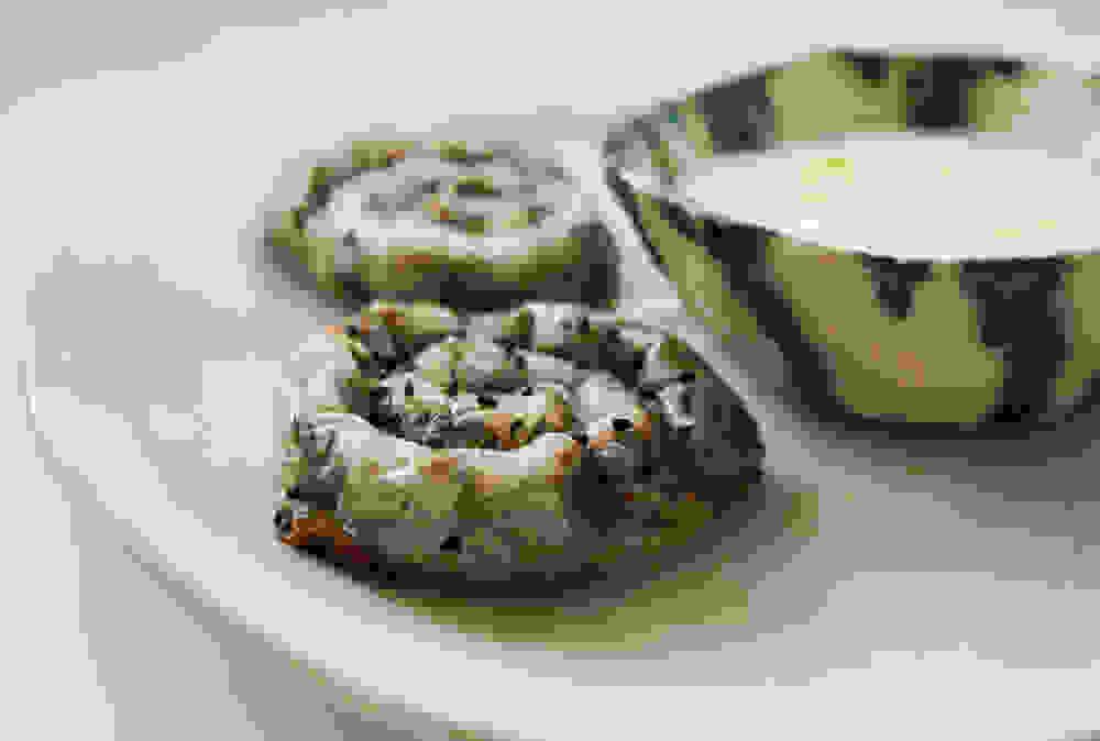 burrekas snails next to a yogurt bowl