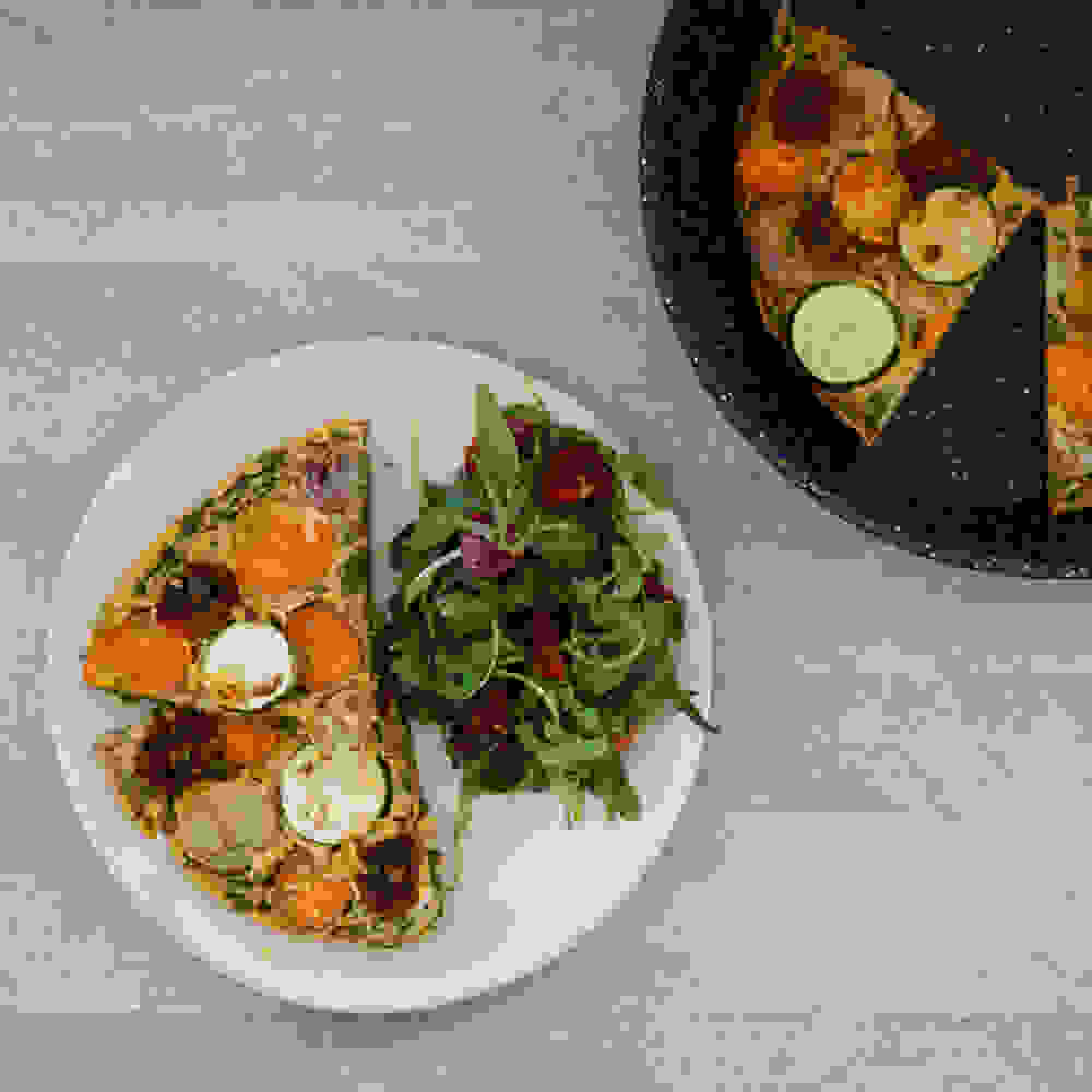vegan lentil frittata on a serving plate flat lay point of view